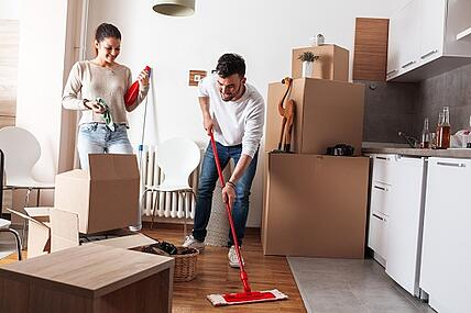 couple cleaning and moving out of house