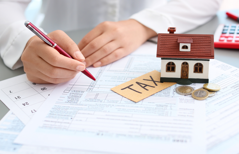 person calculating rental property taxes
